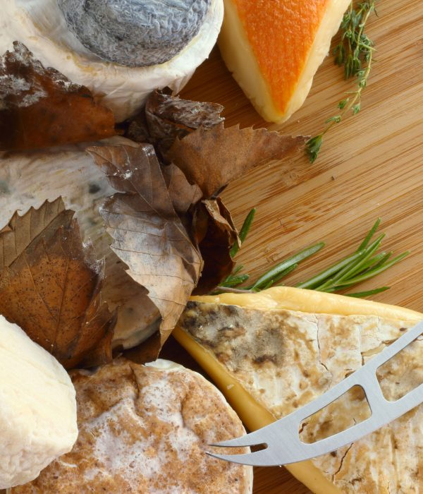 French Cheese composition on wooden board close-up