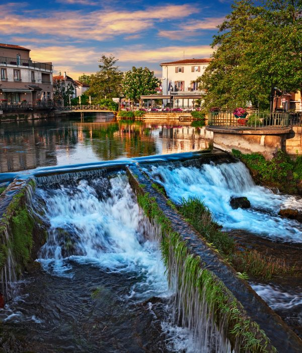 L'Isle-sur-la-Sorgue, Vaucluse, Avignon, France: picturesque landscape at dawn of the town surrounded of the water canals